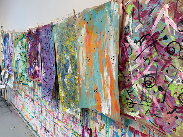 painted paper hanging to dry